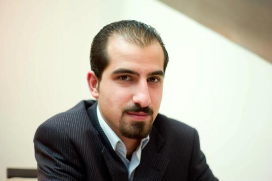 A salute to Bassel al-Safadi (photo) in his detention and Aliaa Khalifa in her hospital