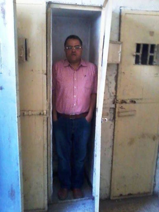 The photo shows a solitary cell in one of the liberated State Security branches in Syria .....A defected soldier who used to work in this branch said that they used to put two or even three detainees in this Standing Coffin